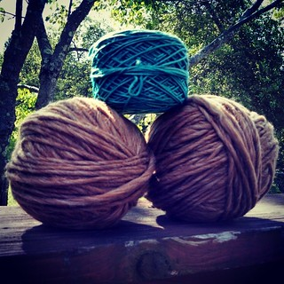 I like big balls, and I can not lie... That's a #Madelinetosh worsted #yarncake on top, 2 balls of #BrownSheepCompany Burly Spun below... Which I found 3 knots in, ugh!! #knitterproblems #knitstagram #yarn #knitting