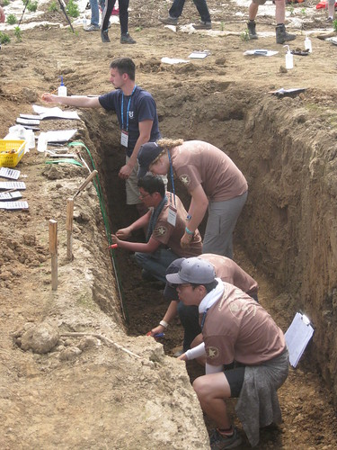 Students dig-in with their competition during the 1st International Soil Judging Contest held in Jeju, South Korea in June.