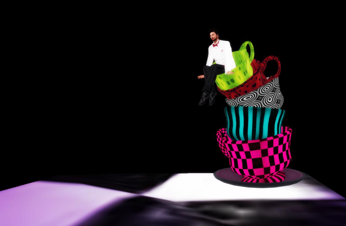 Ricco sitting on tea cups