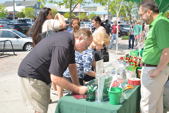 Rehoboth Site Director Dennis Huffman handed out raffle tickets and prizes at the location's 15th anniversary celebration on May 17, 2014.