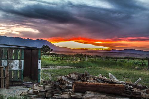 california blue sunset sky orange storm green field grass clouds canon bishopca sierranevadamountains