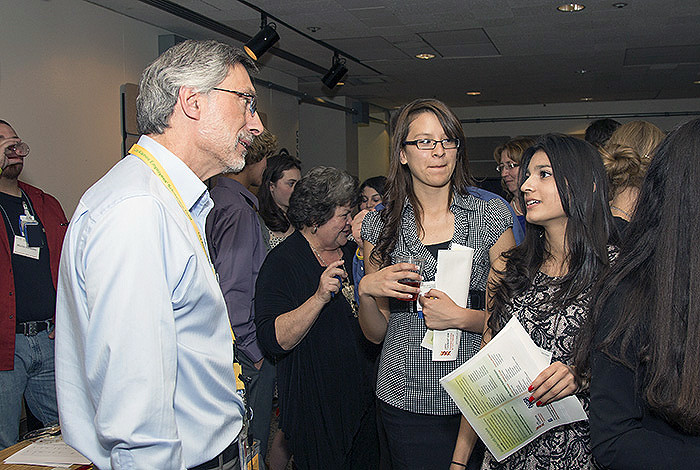 2014 Los Alamos Employees' Scholarship recipient Nicolette Gonzales, right, of Pecos High School talks with Laboratory Director Charlie McMillan at the LAESF campaign kickoff reception.