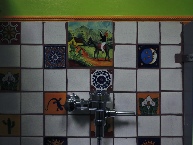 tacky mexican restaurant stereotype-reinforcing bathroom wall art for you to piss out your margarita to (2014)