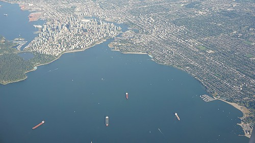 Peering over English Bay, downtown Vancouver and the Westside