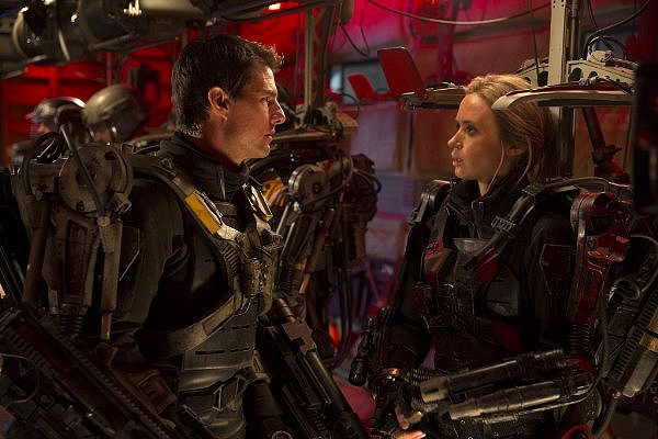 Tom Cruise and Emily Blunt go through the paces, over and over again, in EDGE OF TOMORROW.
