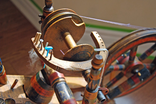 Bobbin and flyer on antique Eastern European flax spinning wheel