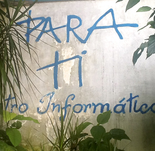 Mural enscribed 'PARA ti tro Information' in the Favelas