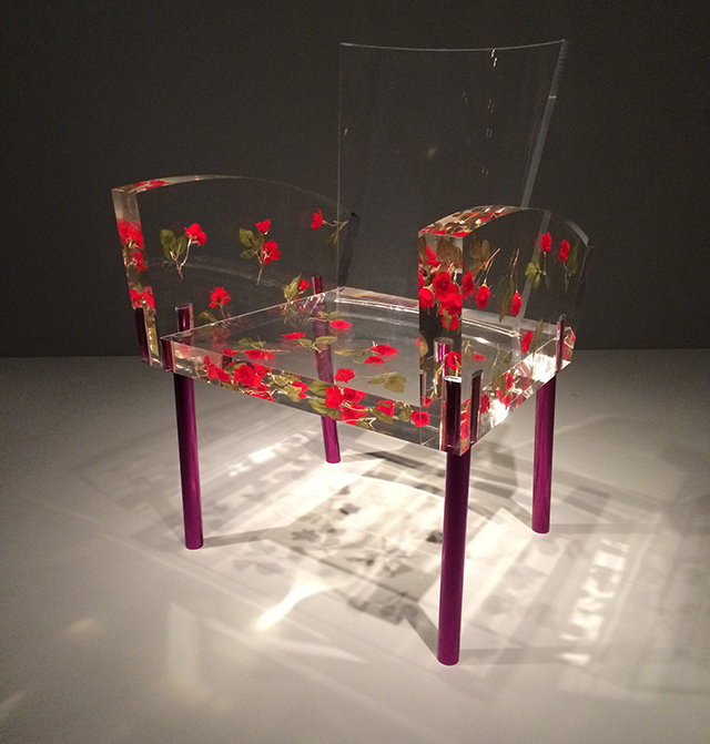 fake roses embedded in Lucite - Miss Blanche chair by Shiro Kuramata