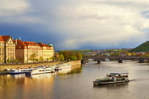 city travel bridge houses sunset sky water reflections river landscape boat republic sundown czech prague praha sight vltava moldova moldava