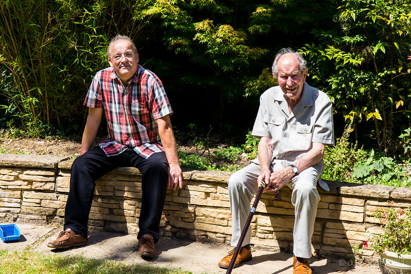 Paul and Dad, sitting in the sun in the garden