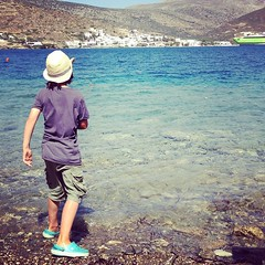 Skimming stones as the huge ferry leaves. He can do six bounces. #amonthingreece