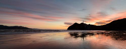 light newzealand sky lighthouse beach water clouds sunrise dawn sand rocks tide castlepoint wairarapa
