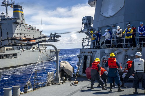 George Washington Carrier Strike Group Re-Supplies Under Simulated Threat