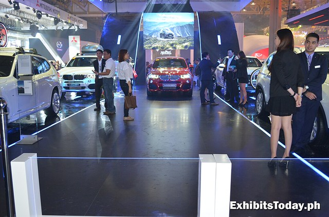 front of BMW trade show display
