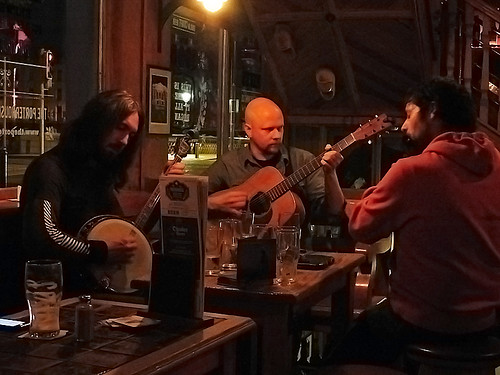 Musicians tuning up at the Porterhouse Temple Bar, a brewpub in Dublin, Ireland