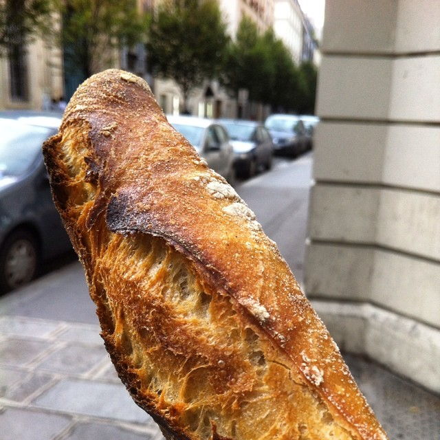 Heading to dinner with @eatlivtravwrite and @monicashaw. Baguette in hand. #paris