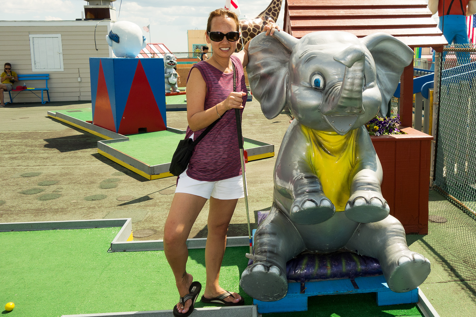 Glinda taking a quick break from beating me to pose with the elephant.