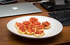 Crostini with olive pate mixed with chopped tomatoes