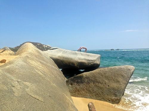 Lina doing wheel pose on La Piscina beach in Tayrona
