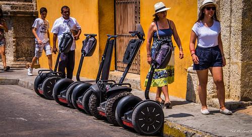 people walking nikon colombia legs wheels hats streetscene sidewalk segway parked bracelets walkers cartagena aprendiz suglasses d600 wooddoor cartagenacolombia tedsphotos nikonfx