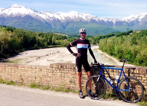 "<p>Don S. seen against a magnificent Italian mountain backdrop next to his custom Gunnar from Mighty Riders of Vancouver, BC.  Don tried out some of the stages of the Giro on his new bike, about which he says: ""bottom line - bike is faster, more responsive, more comfortable, more fun to ride.""</p>"