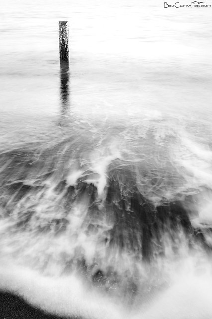 long exposure black and white sea yorkshire post waves surf