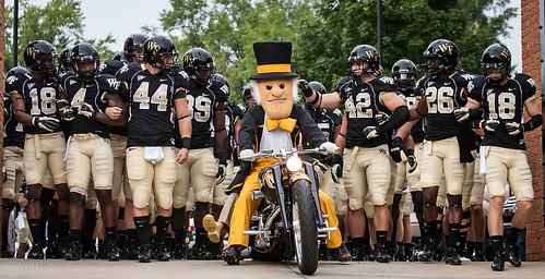 The Demon Deacon leads the football team into BB&T Field
