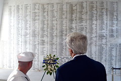 U.S. Secretary of State John Kerry looks at the names of Navy veterans inscribed on a wall at the USS Arizona memorial site in Pearl Harbor, Hawaii, on August 13, 2014. It followed a regional military briefing coming at the conclusion of an around-the-world trip that included stops in Burma, Australia, and the Solomon Islands. [State Department photo/ Public Domain]