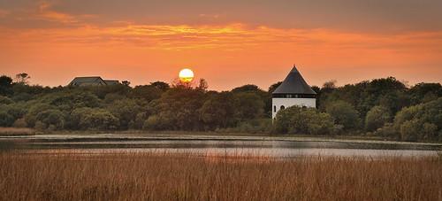 sunset orange sun lake water southwales landscape llynllechowain carmarthenshire naturereserve gorslas