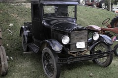 touring car(0.0), automobile(1.0), ford model a(1.0), vehicle(1.0), antique car(1.0), classic car(1.0), vintage car(1.0), land vehicle(1.0), luxury vehicle(1.0), ford model t(1.0), motor vehicle(1.0),