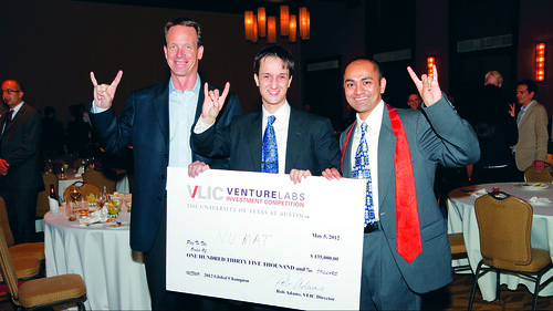 Rob Adams helps NuMat Technologies founders celebrate their grand prize at Texas Venture Labs' Venture Labs Investment Competition, which is held on campus each spring. (Photo by Steve Moakley)