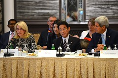 With Japanese Foreign Minister Fumio Kishida and U.S. Secretary of State John Kerry looking on, U.S. Ambassador-at-Large for Global Women's Issues Catherine Russell delivers remarks at a Call to Action event in New York City on September 22, 2014. [State Department photo/ Public Domain]