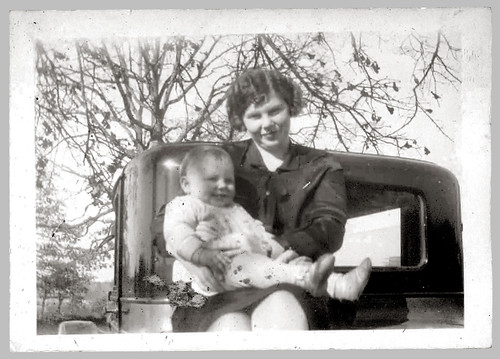 Woman and child on car