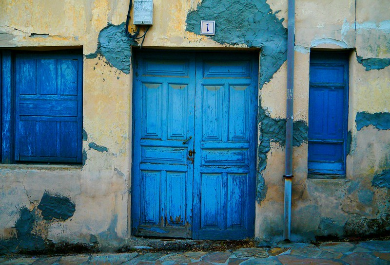 tattered doors in Spanish village