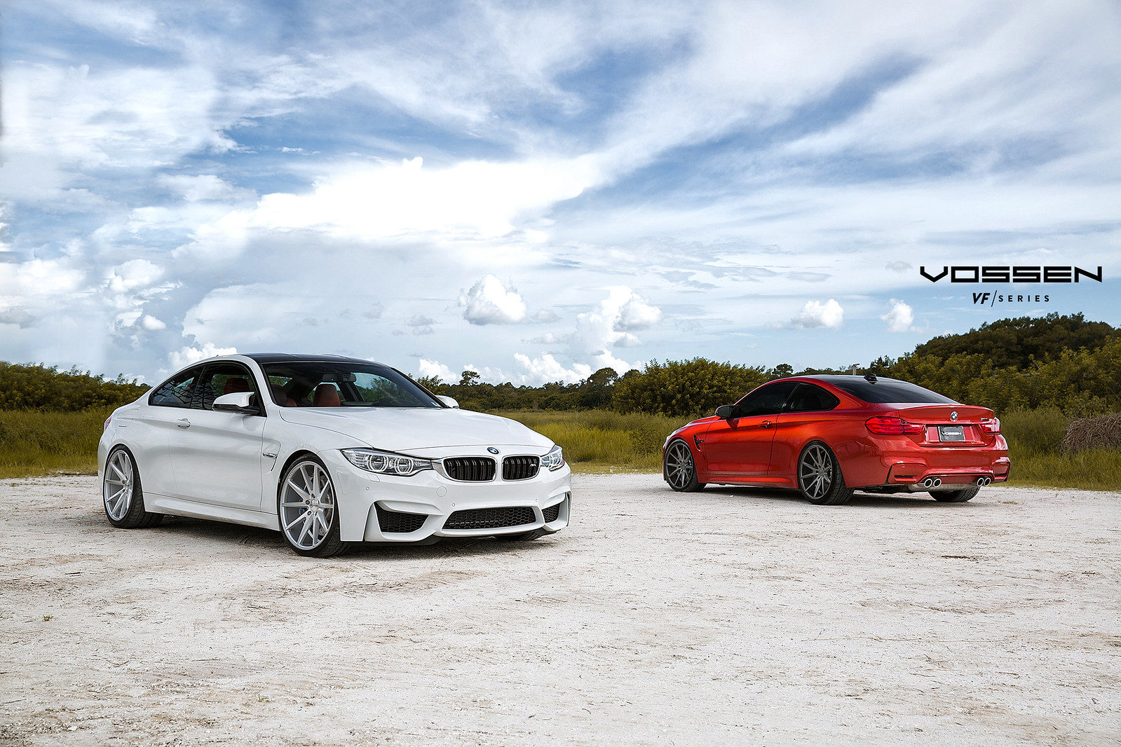 two M4s with Vossen Wheels