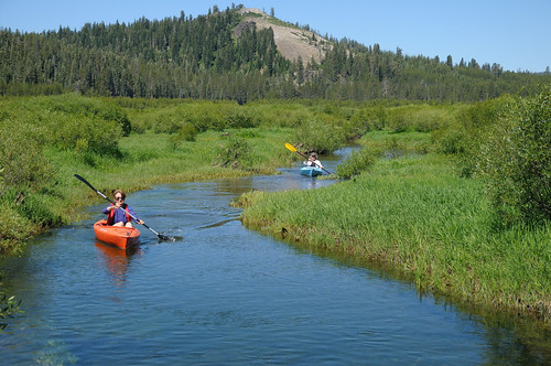 Two kayakers row down an engorged creek through Van Norden Meadow in Royal Gorge on Donner Summit near Lake Tahoe, Calif. Tahoe National Forest, Sierra Nevada. Photo: George Lamson, Used with permission.