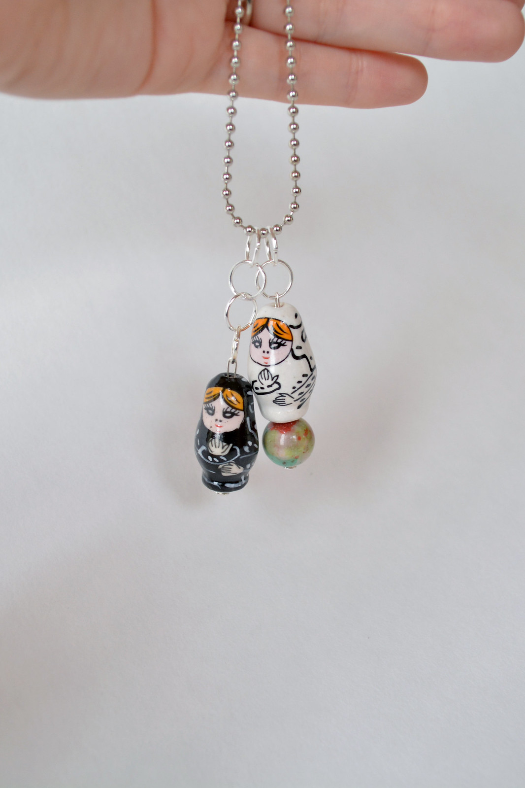 Add some quirk to any outfit with the fast and simple matryoshka doll necklace