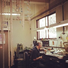 Jewellery workshop at the back of  a shop. I bought some religious votives. #athens