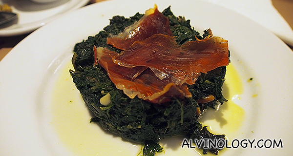 Spinach topped with iberico ham