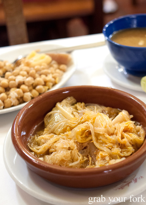 The mercy of the cabbage and dried ham broth from Malacatin restaurant in Madrid, Spain