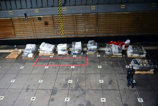 A USS Rushmore sailor stands watch over 91 bales of marijuana aboard the Rushmore at Naval Base San Diego, June 9, 2014. The contraband was seized about 150 miles southwest of the U.S.-Mexico border, June 8, by DHS ReCoM agencies with the assistance of the Mexican navy. (U.S. Coast Guard photo by Petty Officer 2nd Class Gina Ruoti)