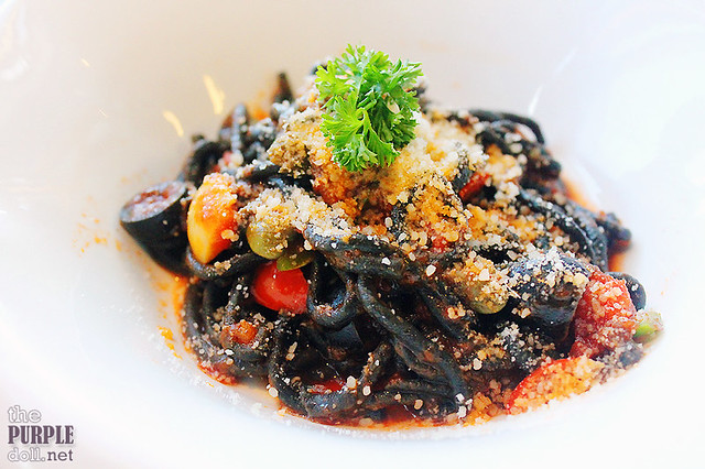 Fresh squid ink pasta puttanesca