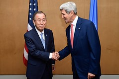 U.S. Secretary of State John Kerry shakes hands with United Nations Secretary-General Ban Ki-moon in Cairo on July 21, 2014, before they sit down to talk about their mutual efforts to support a ceasefire between Israel and Hamas amid conflict in Gaza. [State Department photo/ Public Domain]