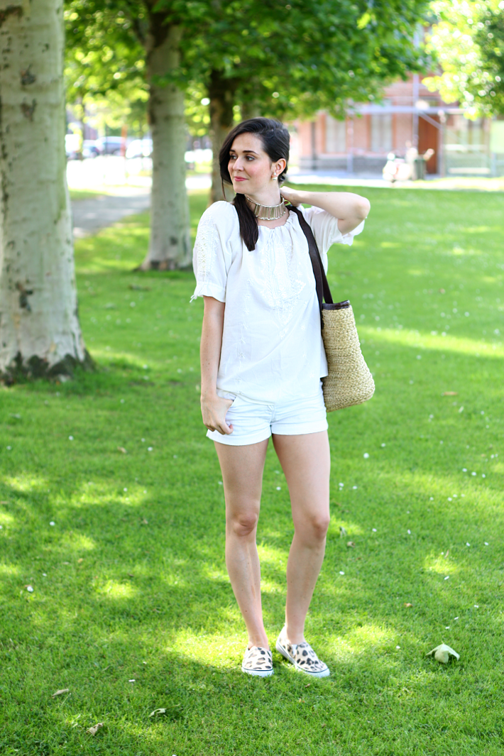 white blouse white shorts leopard slip ons
