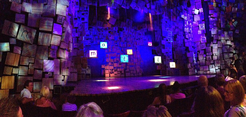 Matilda opening stage, with the letters of the play's name in coloured squares above the stage