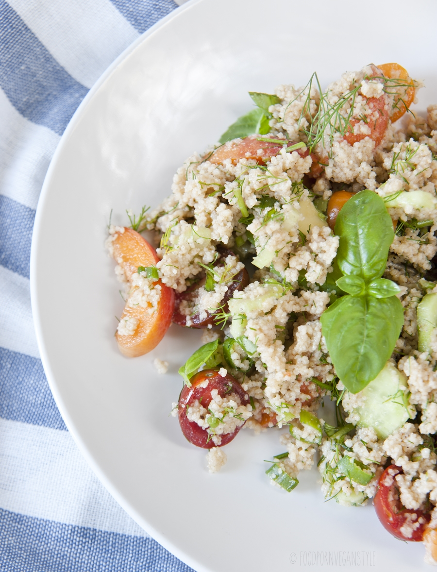 Light and fresh summer salad with couscous, cherry tomatoes, apricots and basil