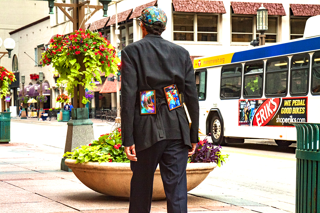 Man-with-small-paintings-strapped-to-back--Minneapolis