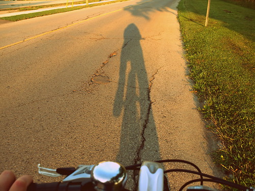 shadow self portrait on bicycle