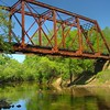The Chunky River rail bridge is a Pratt through truss that was built in 1905 and is still in daily use on the KCS Meridian Speedway. It's awesome watching the train come across it from down at the water level.