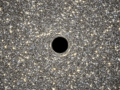 Hubble Helps Find Smallest Known Galaxy Containing a Supermassive Black Hole